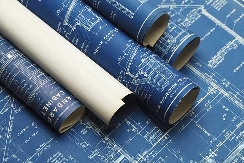 rolled up blueprints